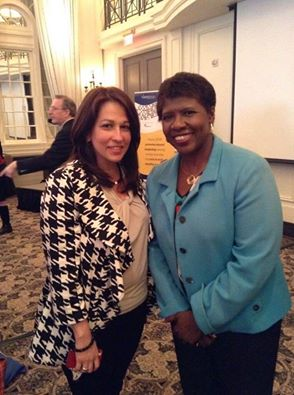 Carol Robles-Román with Gwen Ifill in 2014